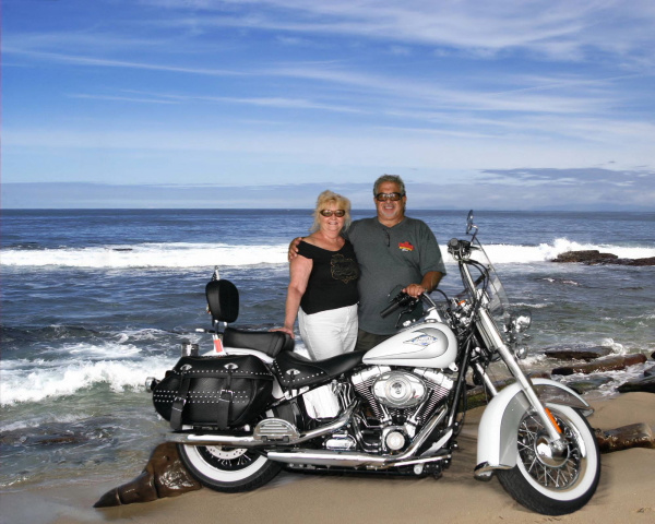 [Image: Couple with Motorcycle on Beach]